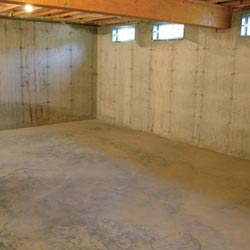 A cleaned out basement in Jacksonville, shown before remodeling has begun