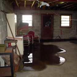 A flooded basement showing groundwater intrusion in Fayetteville