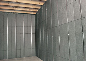 SilverGlo™ insulation and metal studs making up our Basement to Beautiful™ panels.  Installed in Goldsboro.