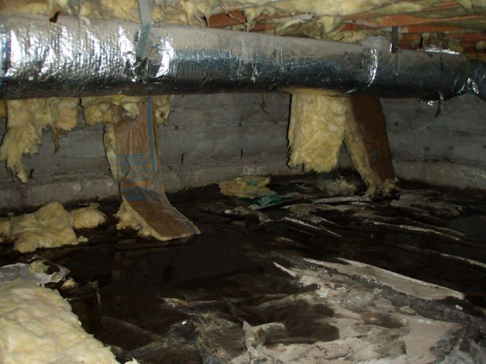 Fibergl Insulation Dripping Off A Floor Joist In Soaked Crawl E With Think Black