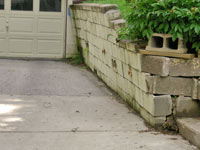 a failing retaining wall around a driveway in Fayetteville