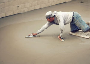 smoothing out the grout in a slab releveling project in Sanford