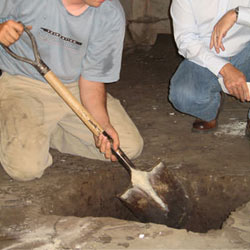 Digging a hole for the engineered fill used in a crawl space support system installation in Sanford