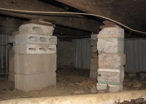 crawl space repairs done with concrete cinder blocks and wood shims in a Hope Mills home