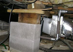 a poorly designed crawl space support system installed in a Leland home
