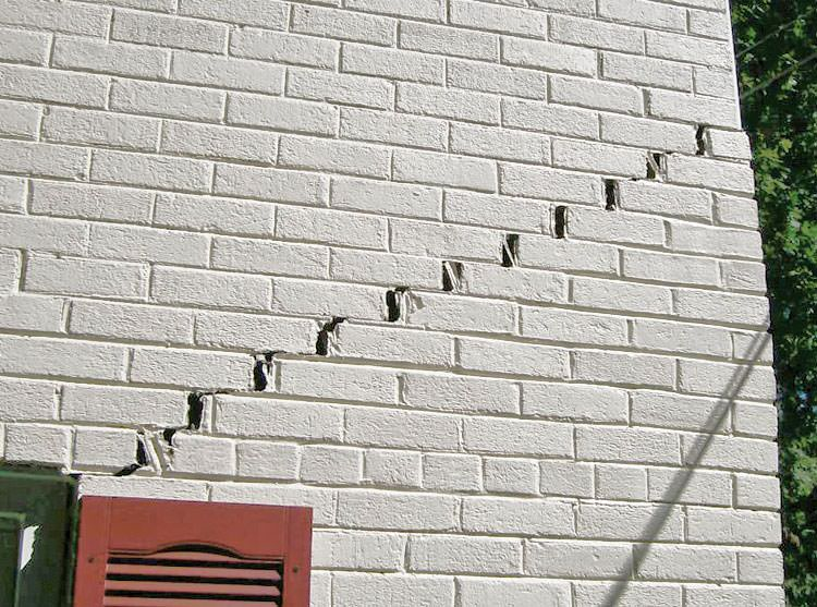 stair step cracks showing in a home foundation in spring lake - Fixing Foundation Cracks