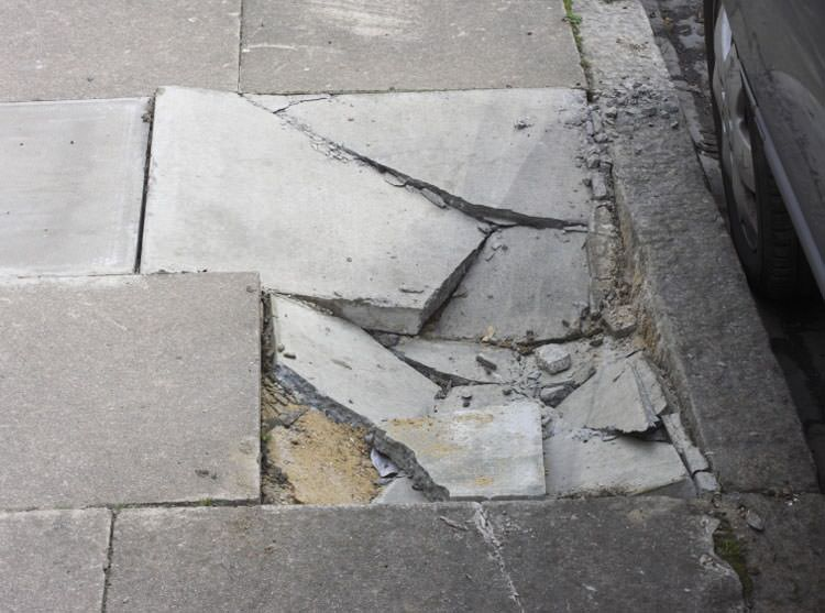 Superb Photo Of A Sinking Concrete Sidewalk With Cracks In Maxton