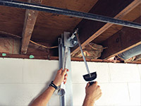 Straightening a foundation wall with the PowerBrace™ i-beam system in a Lumberton home.
