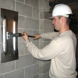 installing a wall anchor to repair an bowing foundation wall in Lumberton