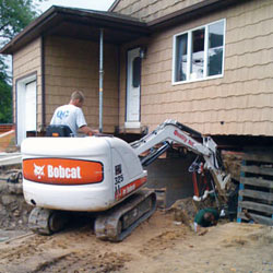 Excavating to expose the foundation walls and footings for a replacement job in Kinston