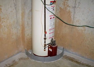 A water heater in Hampstead that's been protected by the FloodRing® and a perimeter drain system.