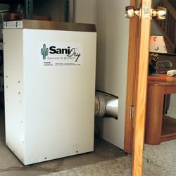 A basement dehumidifier with an ENERGY STAR® rating ducting dry air into a finished area of the basement  in Rocky Point