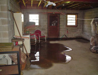 a flooded basement floor in a Rocky Point home