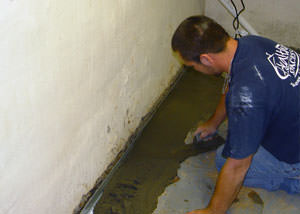 Restoring a concrete slab floor with fresh concrete after jackhammering it and installing a drain system in Dudley.